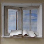 Window with book and sky