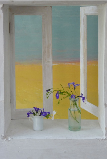Blue flowers, yellow landscape