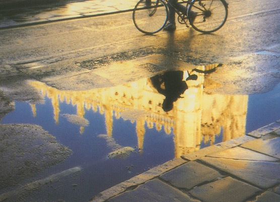 Kings College, Cambridge reflected in a puddle, with bicycle