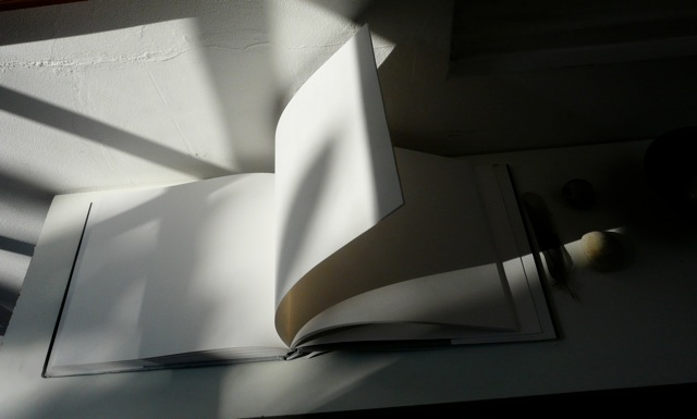 Postcard_White Book, Turning Page and Stones